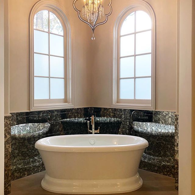 Master tub platform as a part of our Memorial Dr remodel. PM: Andrew Pudlo Interior Design: @eklektik_interiors  #apbuilders #masterbathroom #freestandingbath #antiquemirror #crystalchandelier #houstonbuilder #remodel