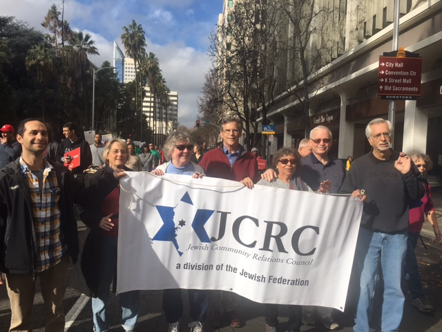 "From left, JCRC leaders and friends Ryan Pessah, Muriel Brounstein, Carol Velarde, Bruce Pomer, Choco Leandro Dresser, Bob Dresser, and Dan Weitzman marched in the annual ""March for the Dream"" parade, which honors the legacy of Dr. Martin Luther King."