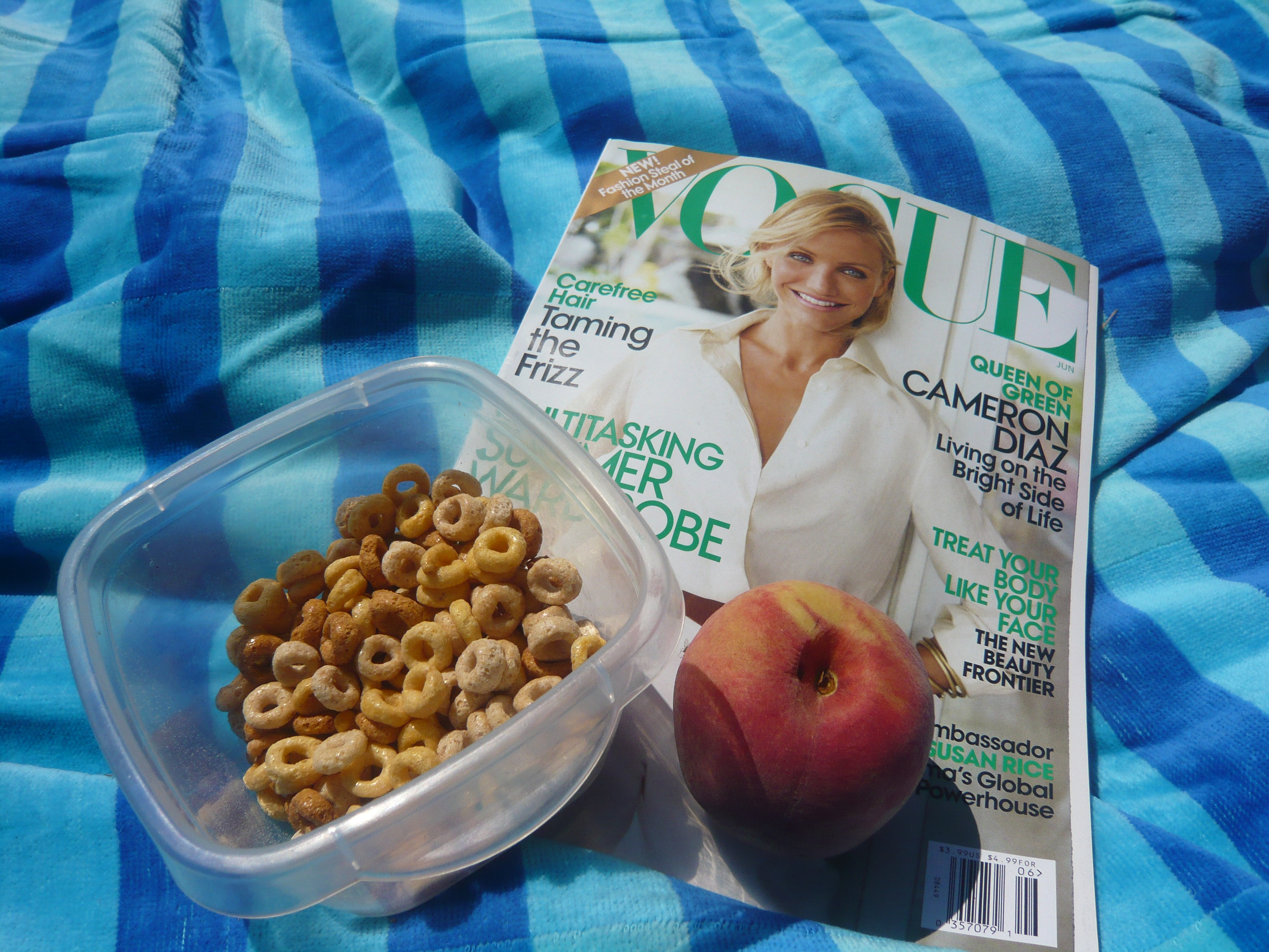The Vogue that arrived today, Multi-Grain Cheerios, and a warm and juicy peach.
