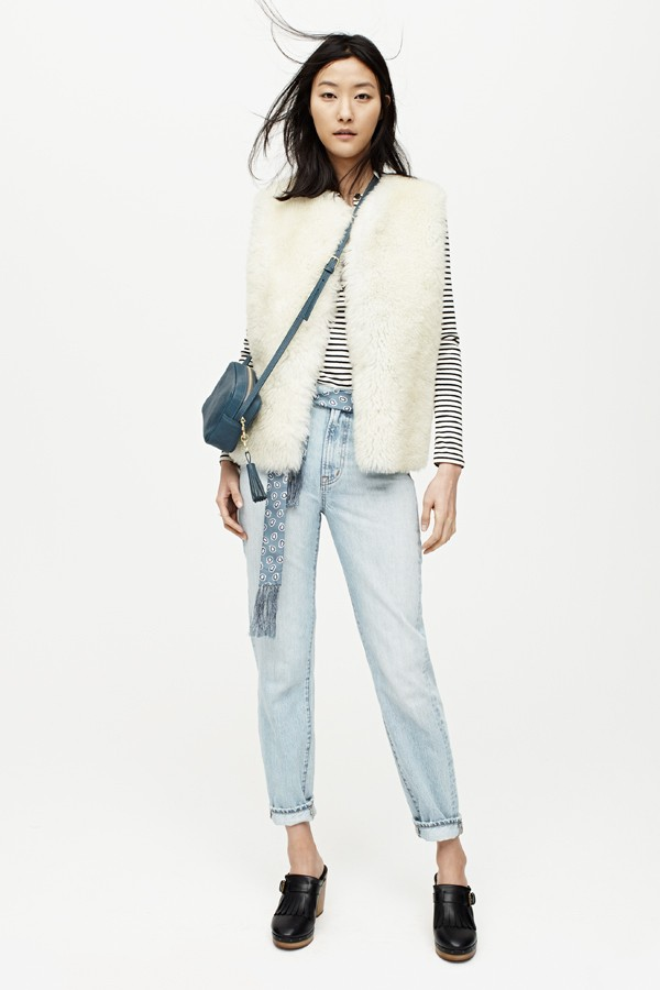 white shearling vest with henley and jeans.jpg