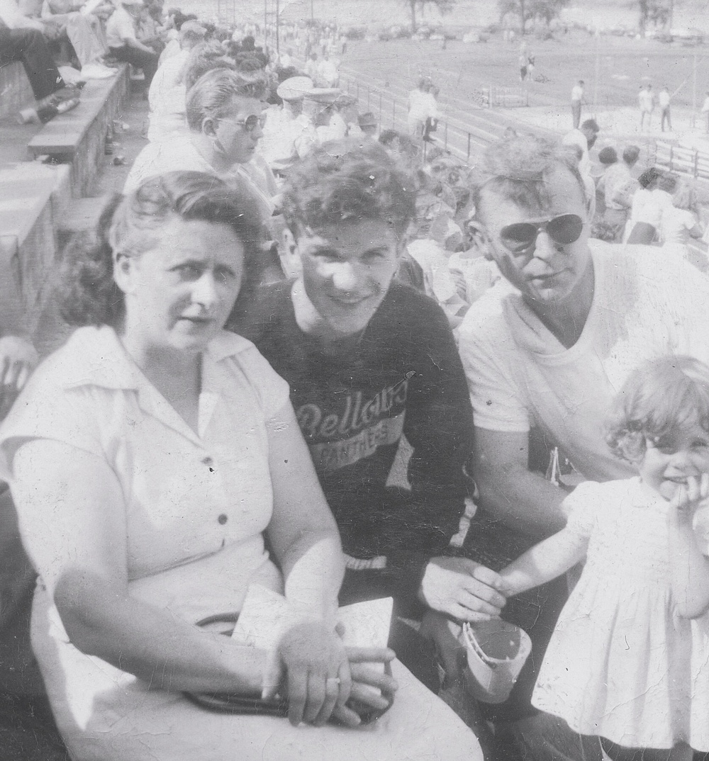 Bellows High School NY 1948  Edmund held the New York State High School 1/2 mile track record for many years (shown here with his foster family)