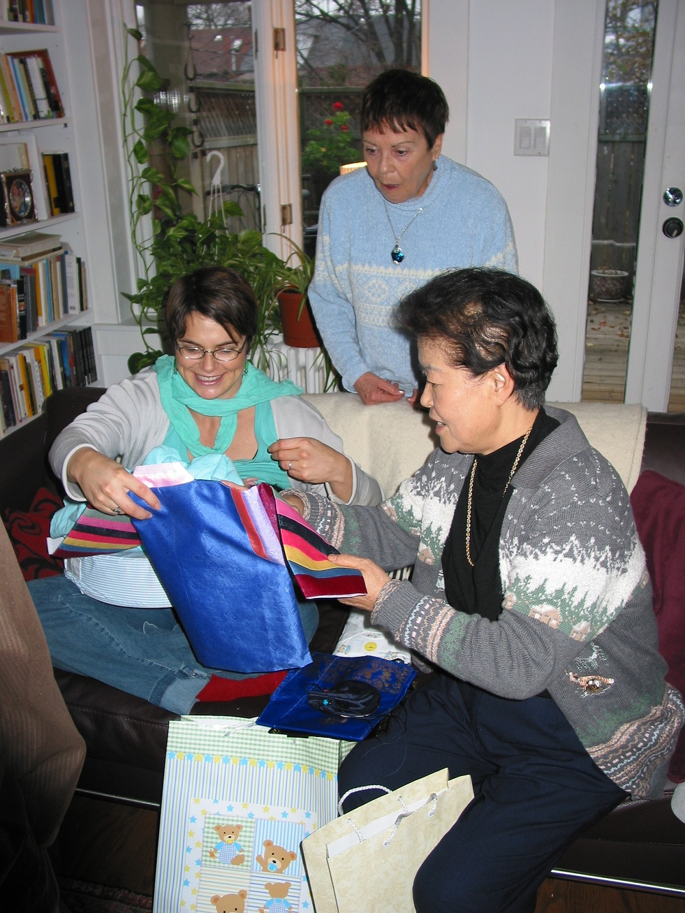 My mother exclaiming over my son's traditional Korean first year outfit in 2006; she died less than two years later, last day of August 2008.