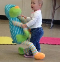 1yr old moving with big doll.jpg