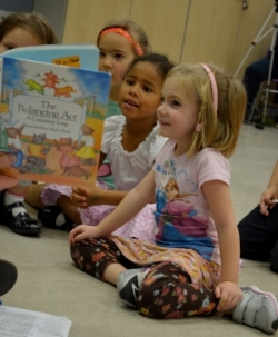 Cora enthralled in music & Literature at 5 yrs old