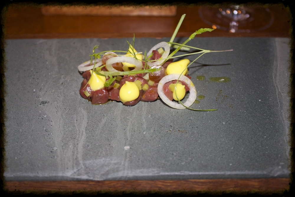 Raw valley venison, charcoal oil, mustard and fennel sweets