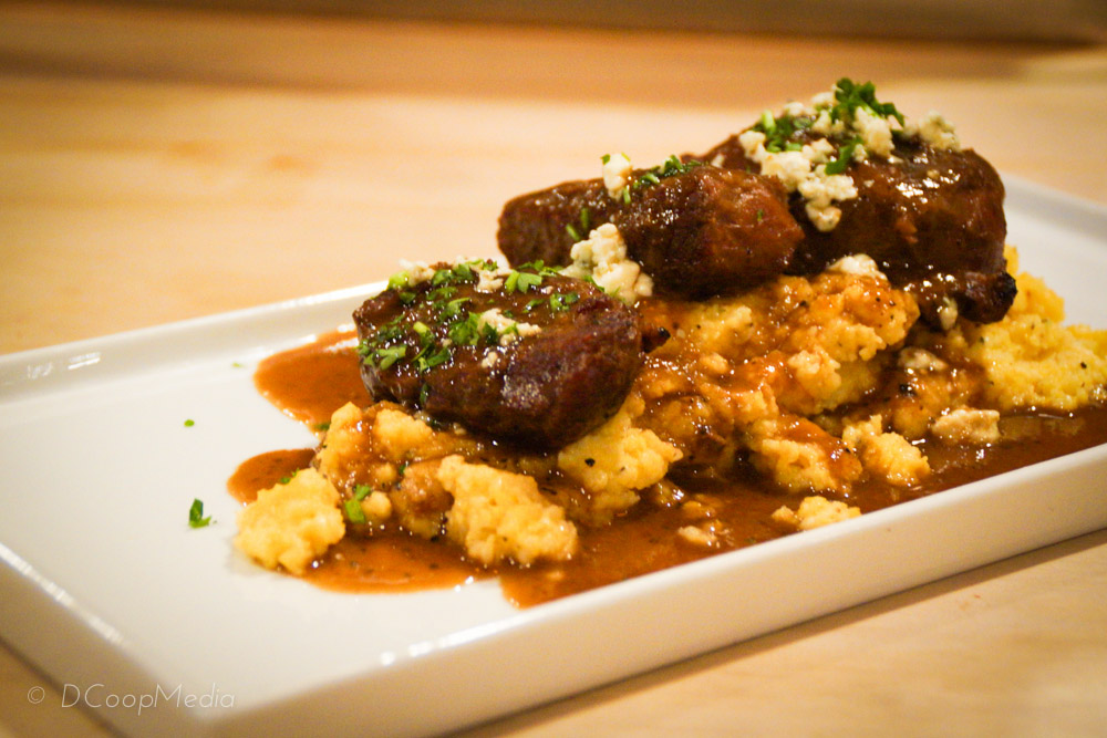 Braised pork cheeks with gorgonzola grits.