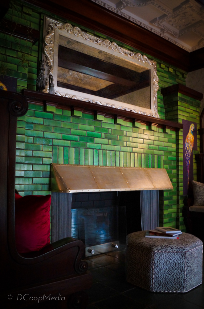 Original tiled fireplace in the Entry by Ana Maria Martinez-Stumpo of PH Design Interiors