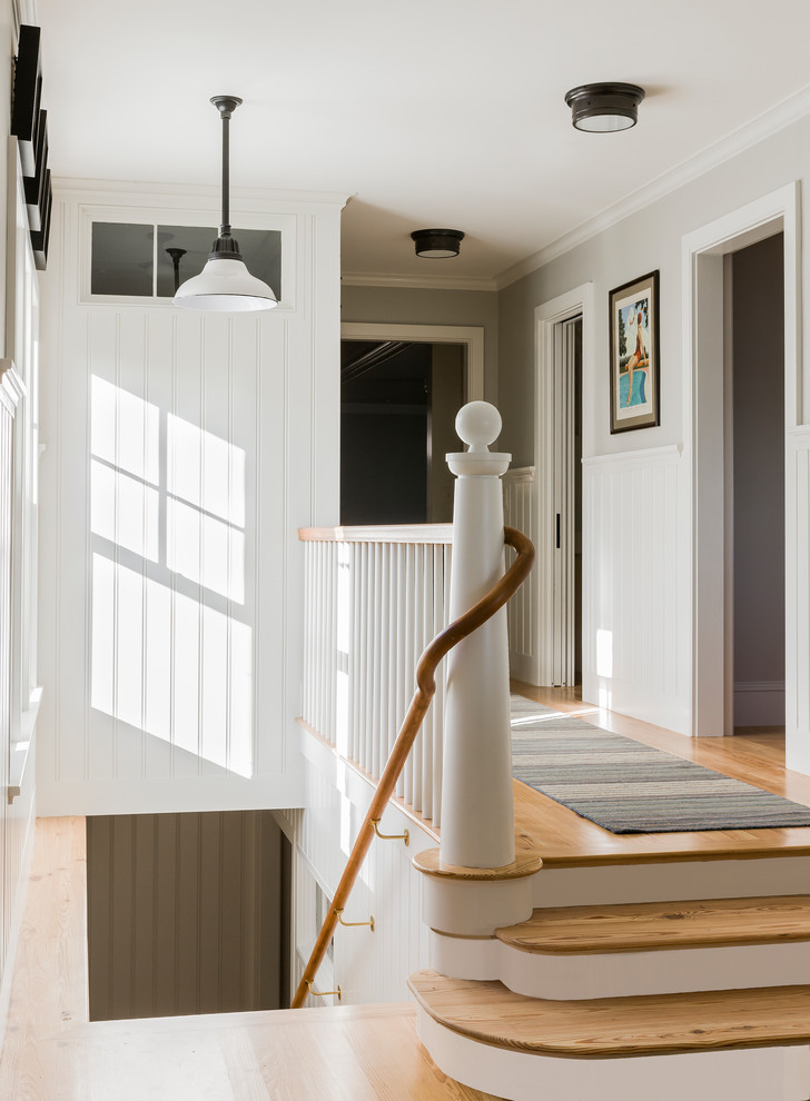 Newel crafted by Stephen Terhune Woodworking in a North Shore Seaside Cottage designed by Carpenter & MacNeille | Photo by Michael J. Lee