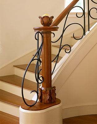 Custom iron & carved wood newel by Knickerbocker Group.  Residence designed in collaboration with John Morris Architects // © brian vanden brink