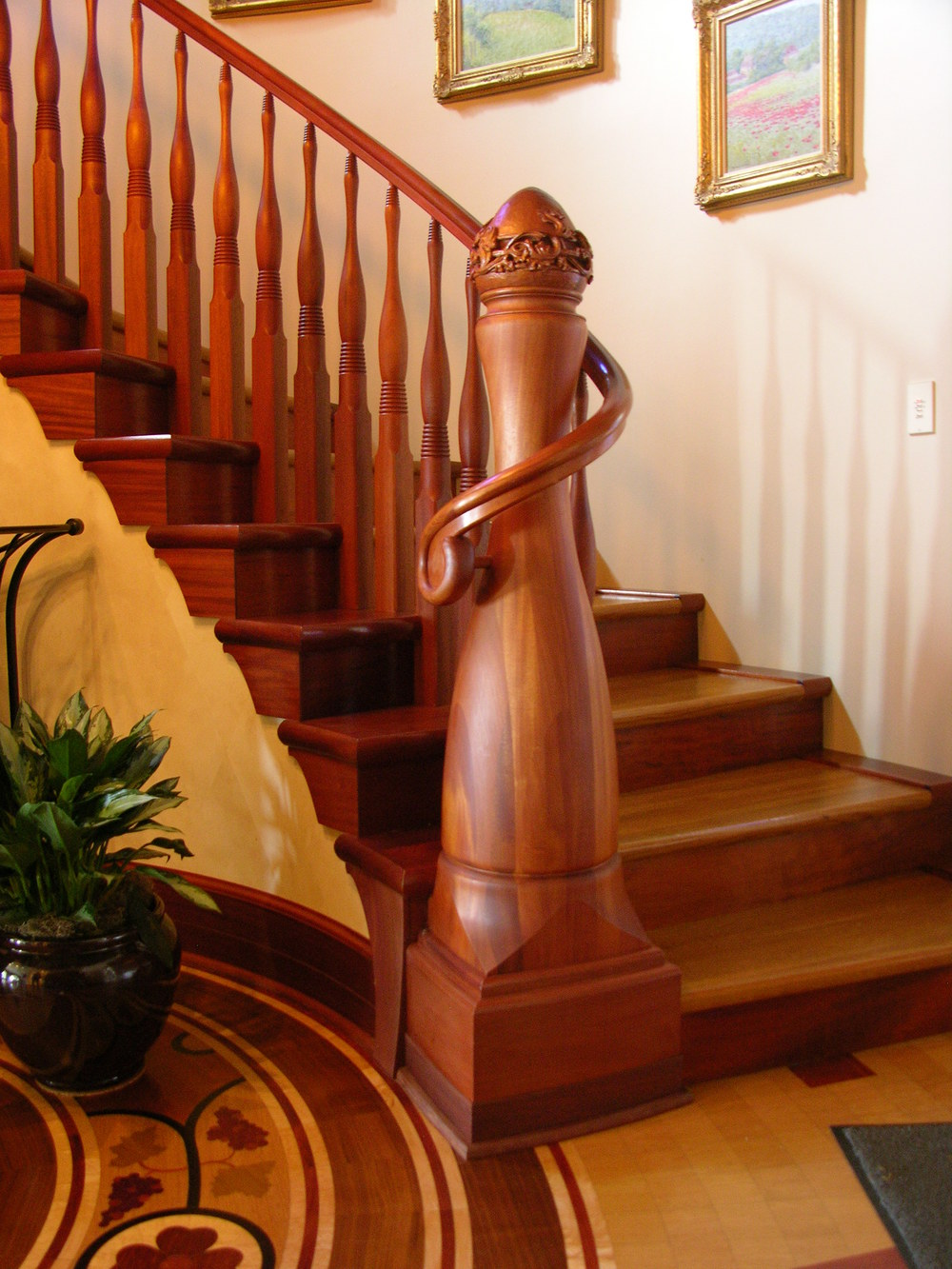 Mahogany newel post and rail by Master Woodworks | Photo courtesy Master Woodworks