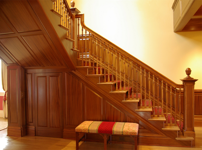 Traditional bespoke staircase in a Wyoming residence by Heartwood Carving | Photo courtesy Heartwood Carving