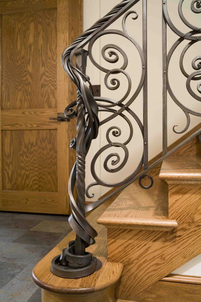 Patinated steel rail & newel by metalist Seth Tyler | Photo by George Lottermoser