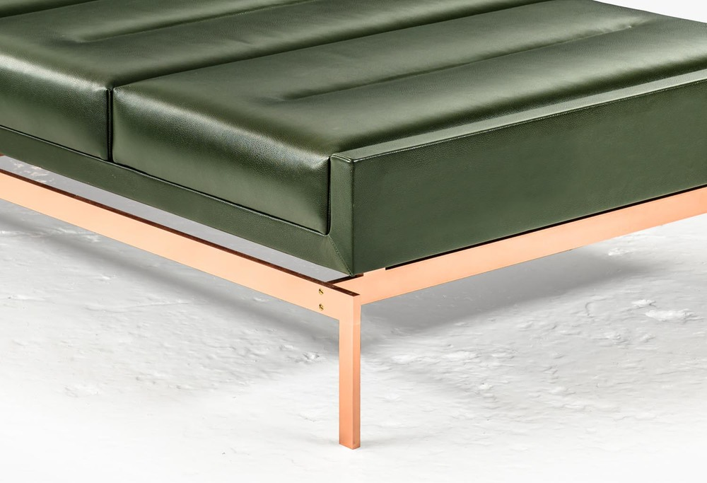 A warm copper base and elegant green leather feature in KGBL's Olivera Chaise Lounge | Photo courtesy KGBL