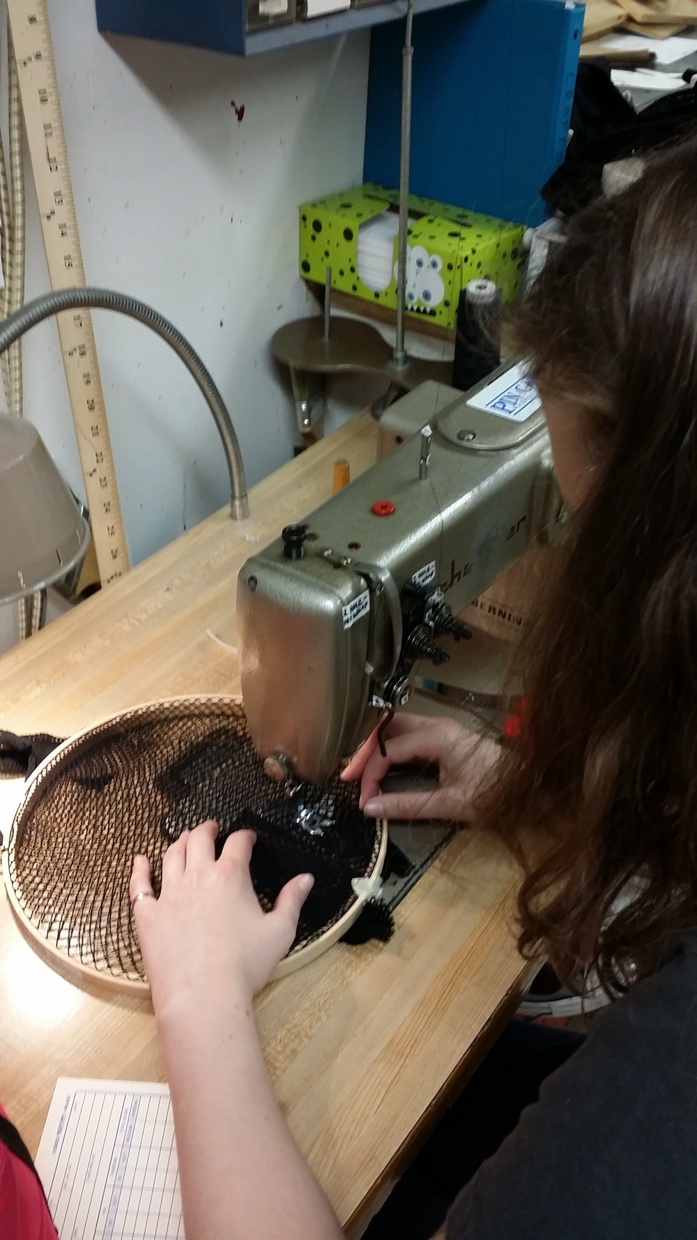 My assistant, Kaitlyn Kaufman, making fishnet gloves for an extra large set of hands