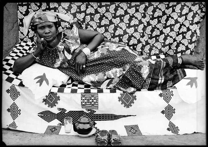 Seydou Keïta, a Malian photographer, is known for his portraiture, particularly of women that simultaneously become a part of their environment and assume command of it.