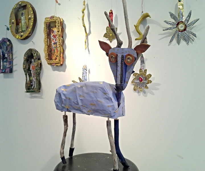 "Portrait retablos, a sculptural deer and tin flowers created during Summer Workshop ""Magical Mexico""."