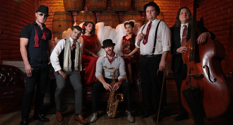 Similar to the stylings of Postmodern Jukebox, Mimi Valentine and the Gentleman's Club play your favorite modern songs in a vintage style