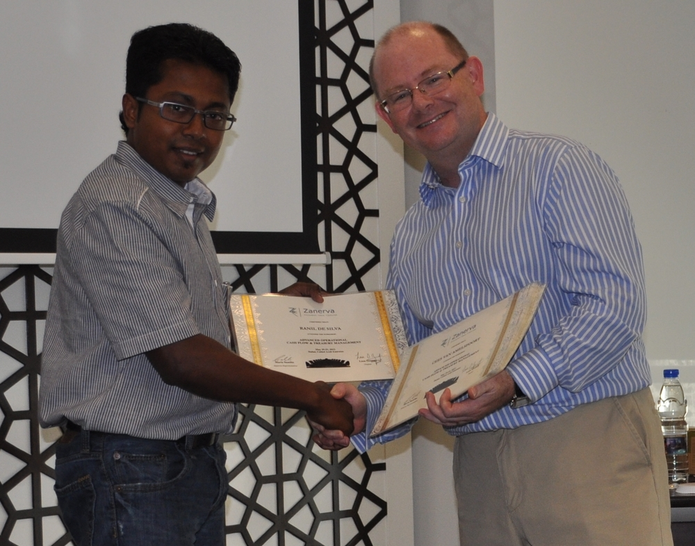 Ranil De Silva (Group Treasury Manager)  receiving his certificate of workshop participation from  Leon Grandy (Zanerva Partner Consultant)