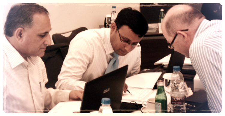 Mohamad Irshad Khan (National Petroleum Company - NAPESCO Kuwait Finance Assistant Manager) and Syed Kaleem Jilanne (Strata Manufacturing UAE Treasury & Asset Accountant)   being guided by  Leon Grandy (Partner Consultant)  on a case study given to them during the Advanced Operational Cash Flow & Liquidity Risk Management Workshop in Duba