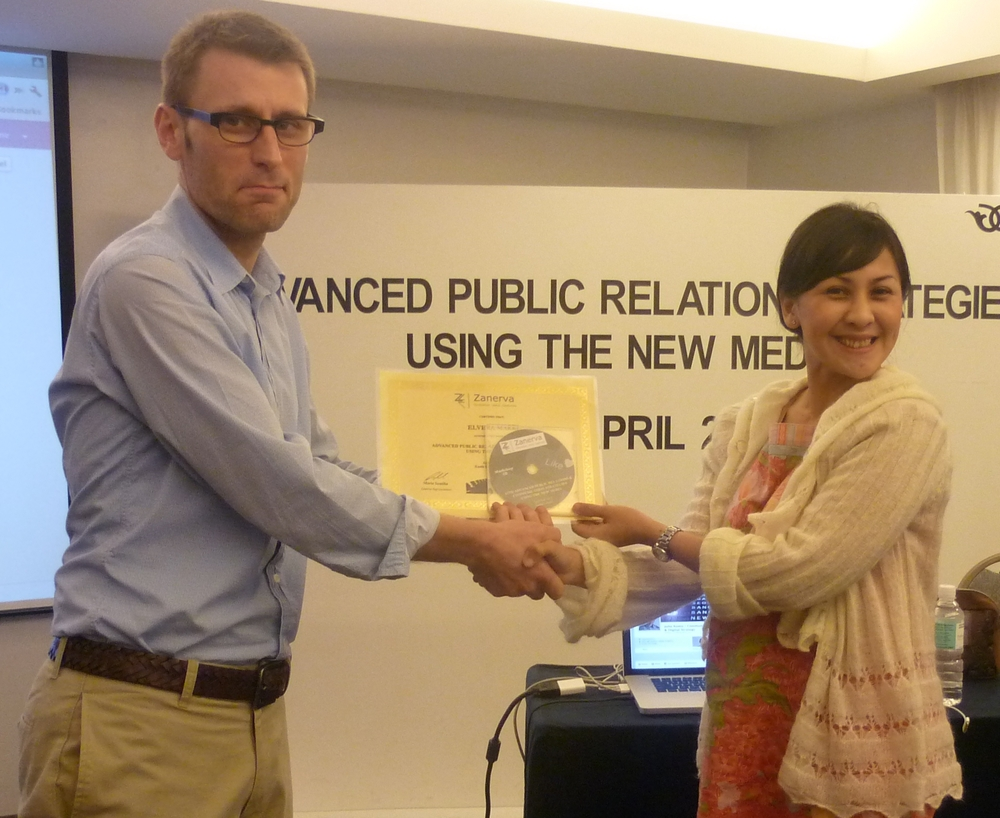 Elvera Makki, Corporate Affairs Manager of Fonterra Brands Indonesia  receiving her certificate of workshop participation from Julio Romo (Zanerva Partner Consultant) for attending the Advanced Public Relations & Communication Strategies Using the New Media in Kuala Lumpur