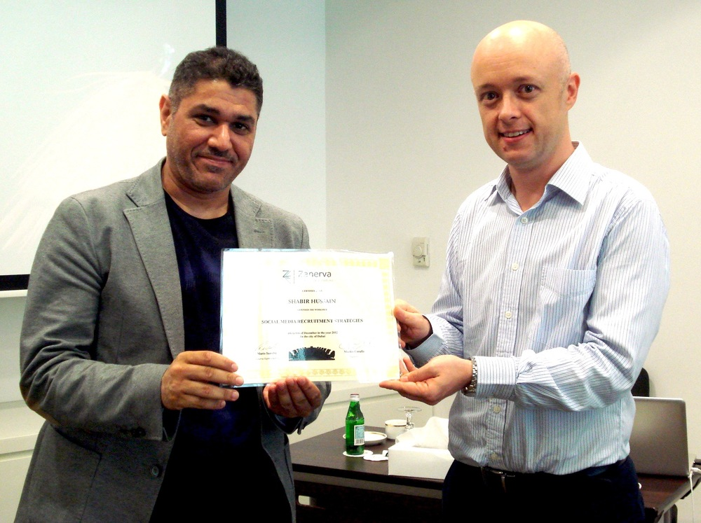 Shabir Hussain receiving his certificate of workshop participation from Martin Cerullo for attending the Social Media Recruitment in Dubai