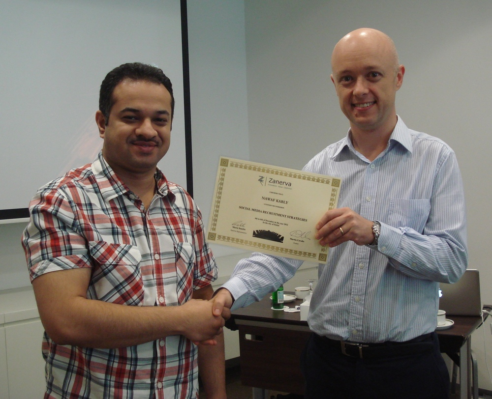 Nawaf Kably receiving his certificate of workshop participation from Martin Cerullo for attending the Social Media Recruitment in Dubai