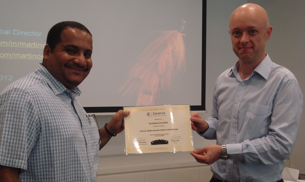 Waheeb Alsubhi teceiving his certificate of workshop participation from Martin Cerullo for attending the Social Media Recruitment in Dubai