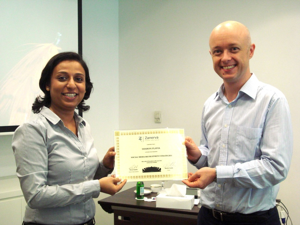 Sharon Flavia receiving her certificate of workshop participation from Martin Cerullo for attending the Social Media Recruitment in Dubai