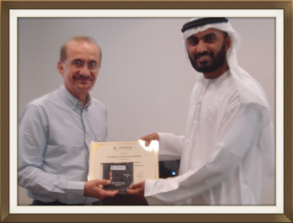 """Sulaiman Salem Al Hammadi - UAE National Development Department Manager at Abu Dhabi Polymers (Borouge) receiving his certificate of workshop participation from Ayadh Farooq during the """"How to Improve Your National Development Program Workshop"""" held in Dubai"""