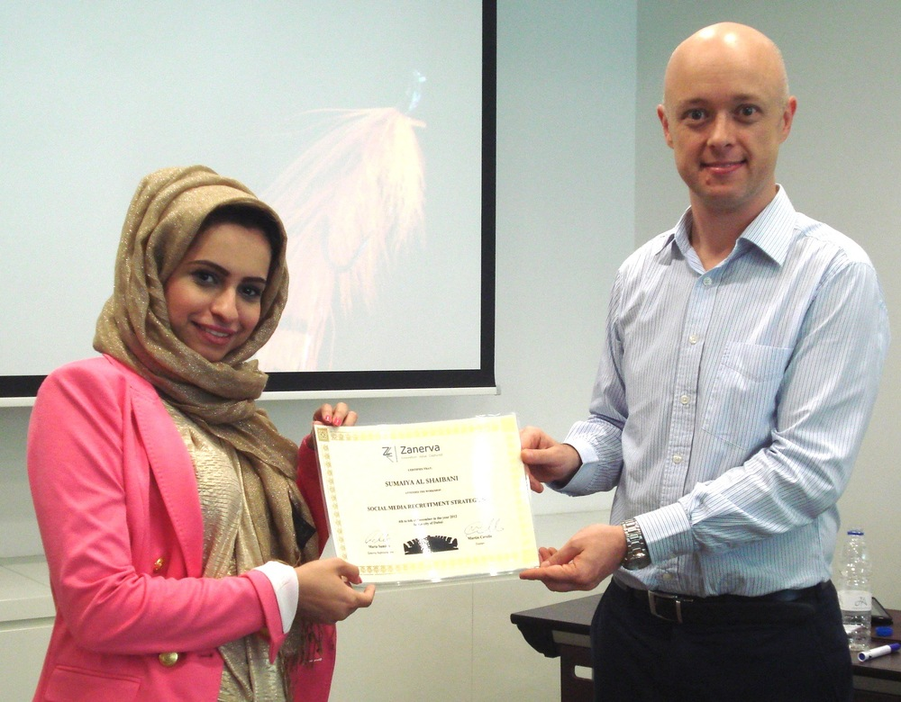 Sumaiya Al Shaibani receiving her certificate of workshop participation from Martin Cerullo for attending the Social Media Recruitment in Dubai