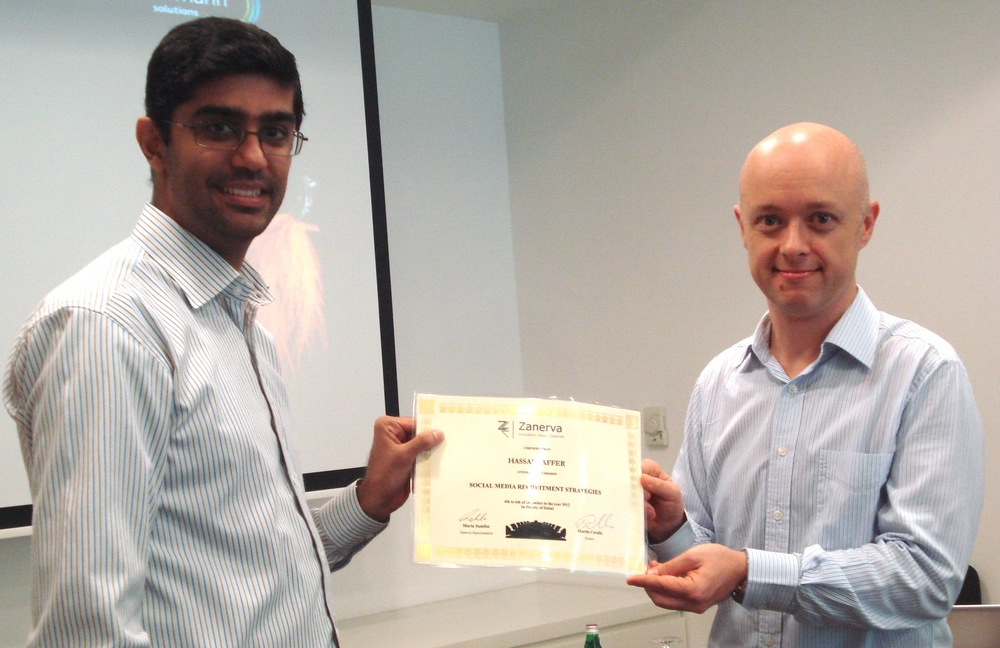 Hassan Jaffer receiving his certificate of workshop participation from Martin Cerullo for attending the Social Media Recruitment Workshop in Dubai