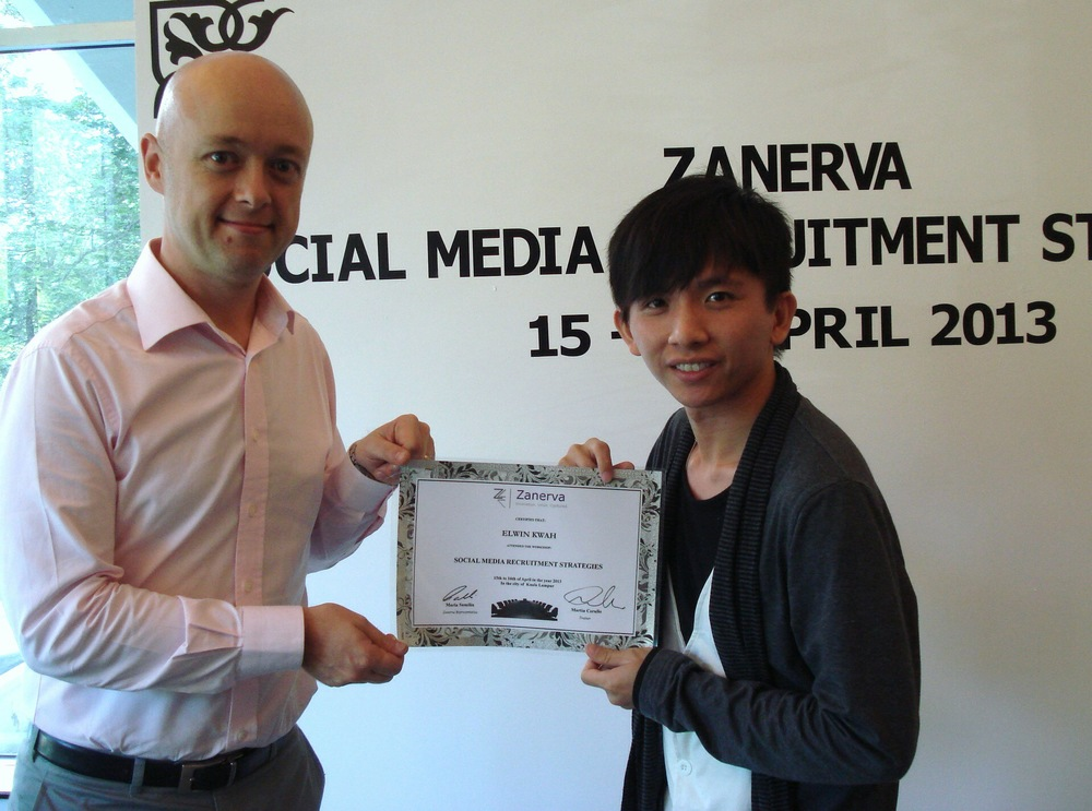 Elwin Kwah Peng Ann, Human Resource Executive at Boon Siew Honda Sdn Bhd  receiving his certificate of participation for attending the Social Media Recruitment Strategies Workshop in Kuala Lumpur