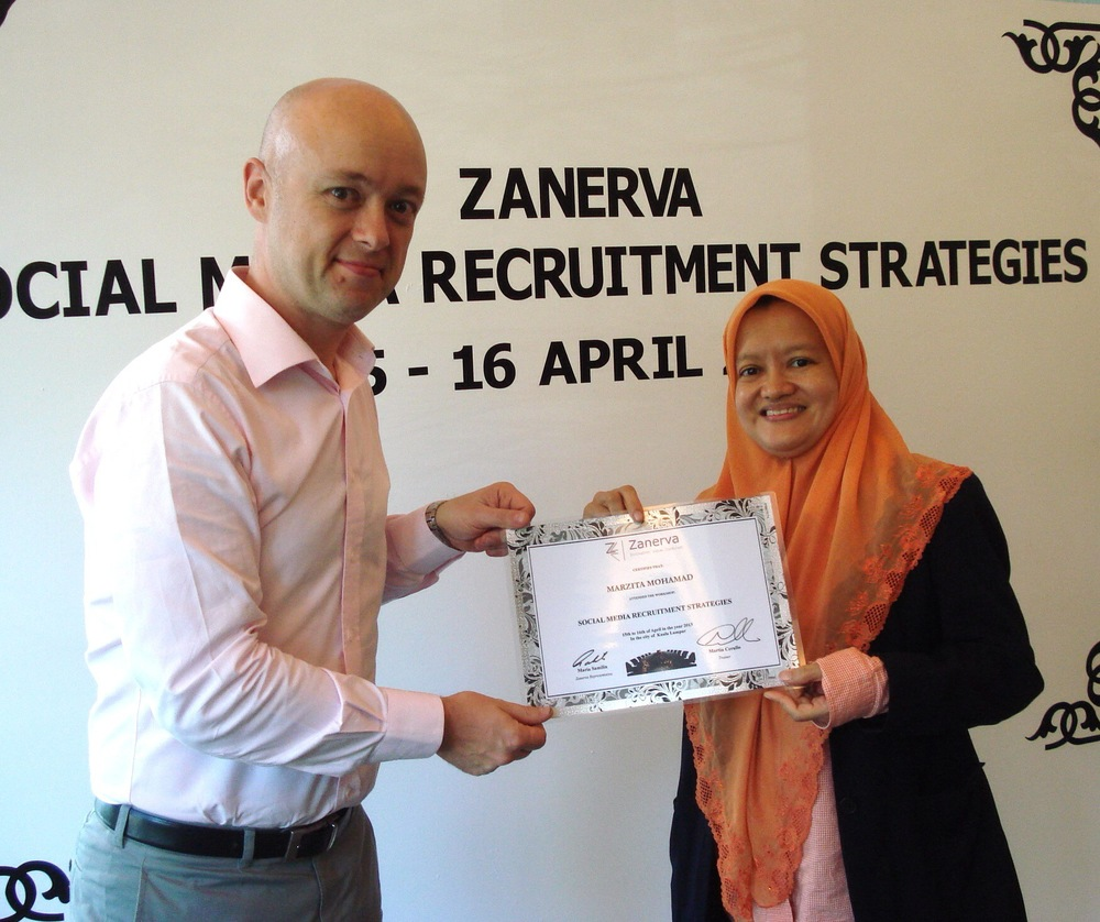 Marzita Binti Mohamad, Principal Assistant Director at Lembaga Hasil Dalam Negeri Malaysia (Inland Revenue Board of Malaysia)  receiving her certificate of participation for attending the Social Media Recruitment Strategies Workshop in Kuala Lumpur