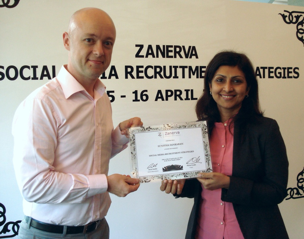 Sunitha Sankaran, Head of HR Services - Group Human Resource at Bursa Malaysia  receiving her certificate of participation for attending the Social Media Recruitment Strategies Workshop