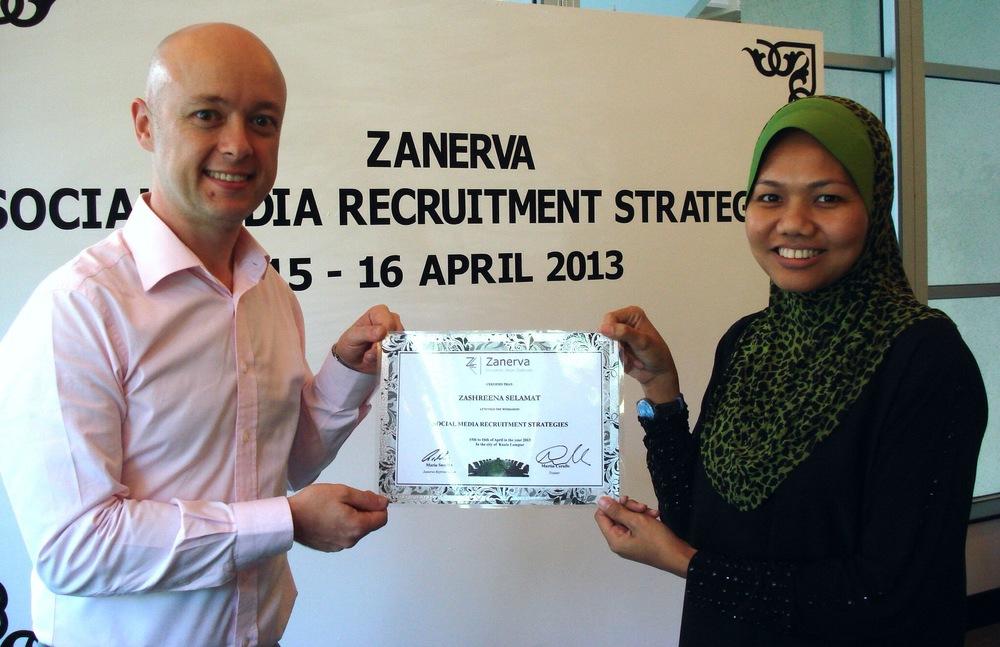Zashreena Binti Selamat, Talent Sourcing Executive at Sapura Kencana Petroleum  receiving her certificate of participation for attending the Social Media Recruitment Strategies Workshop in Kuala Lumpur