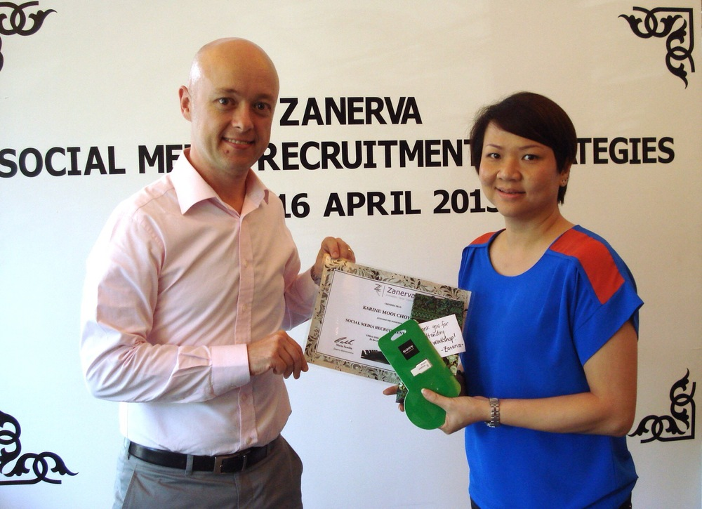 Karine Mooi Choy Lai, Human Capital Management Senior Manager at TGV Cinemas  receiving her certificate of participation for attending the Social Media Recruitment Strategies Workshop in Kuala Lumpur