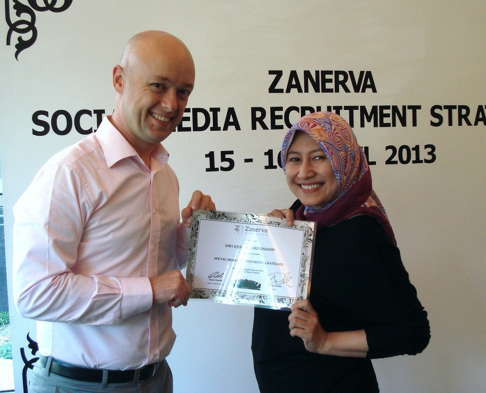 Dwi Endang Sriningsih, Recruitment Manager at Frisian Flag Indonesia  receiving her certificate of participation for attending the Social Media Recruitment Strategies Workshop in Kuala Lumpur