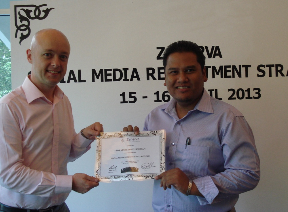 Nor Yusri Abdul Rahman, Senior Human Resource Executive at Sime Darby Energy  receiving his certificate of participation for attending the Social Media Recruitment Strategies Workshop in Kuala Lumpur