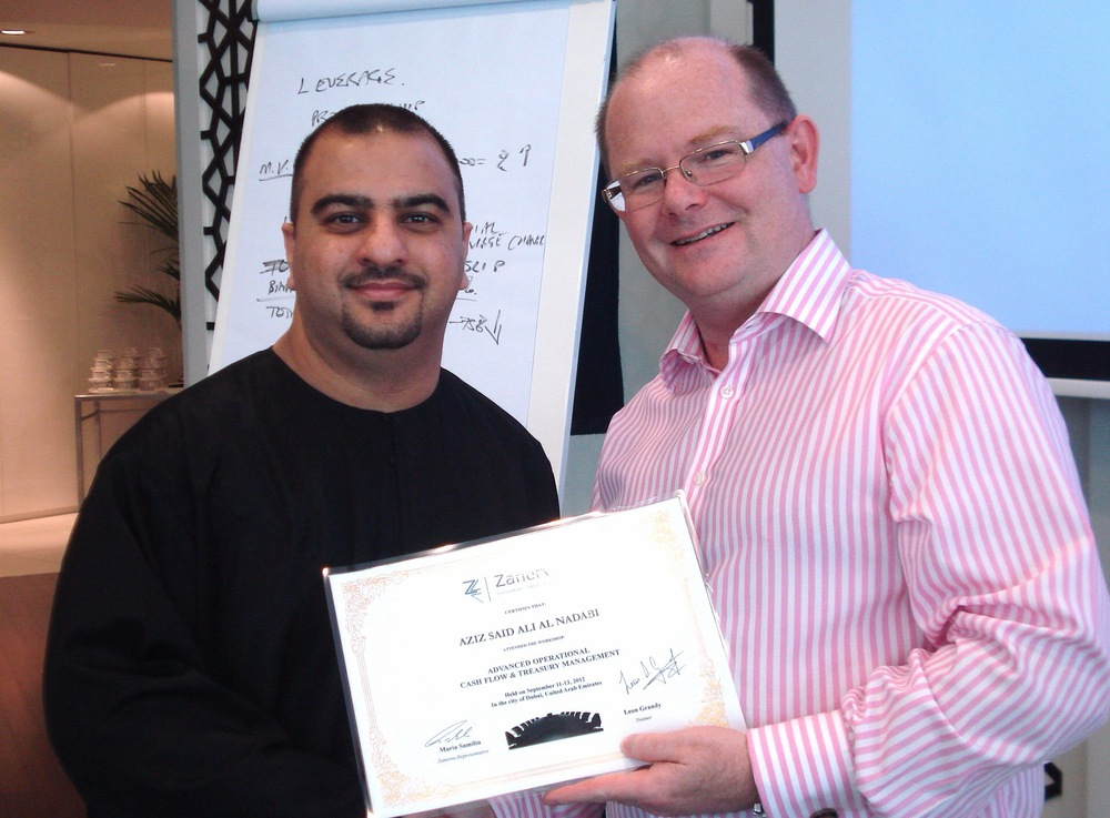 """Aziz Said Ali Al Nadabi, Treasury & Banking Officer at Oman Oil Marketing Company  receiving his certificate of participation for attending the Advanced Operational Cash Flow & Liquidity Risk Management workshop in Dubai                     0   false       18 pt   18 pt   0   0     false   false   false                                       /* Style Definitions */ table.MsoNormalTable {mso-style-name:""""Table Normal""""; mso-tstyle-rowband-size:0; mso-tstyle-colband-size:0; mso-style-noshow:yes; mso-style-parent:""""""""; mso-padding-alt:0cm 5.4pt 0cm 5.4pt; mso-para-margin-top:0cm; mso-para-margin-right:0cm; mso-para-margin-bottom:10.0pt; mso-para-margin-left:0cm; mso-pagination:widow-orphan; font-size:12.0pt; font-family:""""Times New Roman""""; mso-ascii-font-family:Cambria; mso-ascii-theme-font:minor-latin; mso-fareast-font-family:""""MS 明朝""""; mso-fareast-theme-font:minor-fareast; mso-hansi-font-family:Cambria; mso-hansi-theme-font:minor-latin;}"""