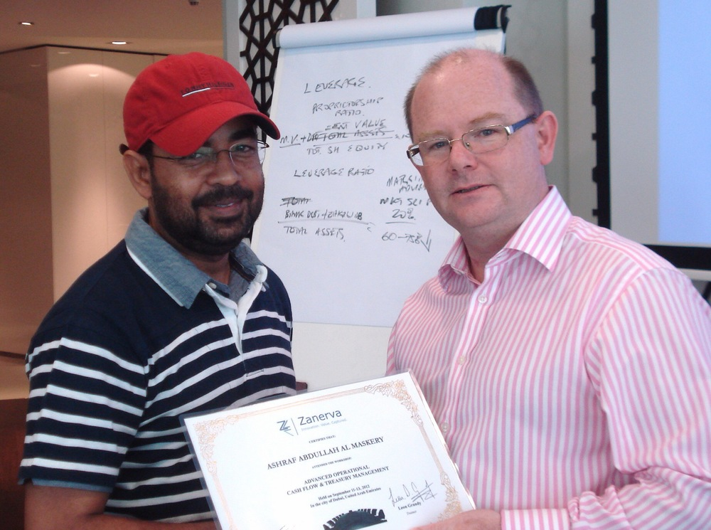 Ashraf Abdullah Al Maskery, Accountant atThe Wave Muscat receiving his certificate of participation for attending the Advanced Operational Cash Flow & Liquidity Risk Management workshop in Dubai