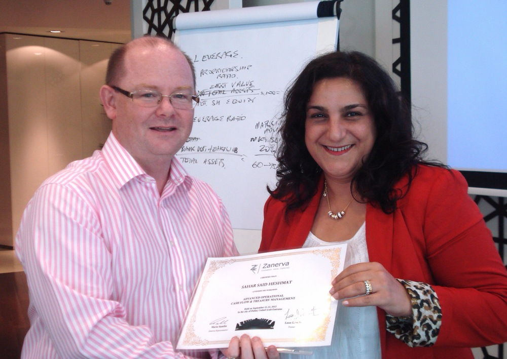 """Sahar Said Heshmat, Director of Treasury and Risk Development at Telecom Egypt  receiving her certificate of participation for attending the Advanced Operational Cash Flow & Liquidity Risk Management workshop in Dubai                     0   false       18 pt   18 pt   0   0     false   false   false                                       /* Style Definitions */ table.MsoNormalTable {mso-style-name:""""Table Normal""""; mso-tstyle-rowband-size:0; mso-tstyle-colband-size:0; mso-style-noshow:yes; mso-style-parent:""""""""; mso-padding-alt:0cm 5.4pt 0cm 5.4pt; mso-para-margin-top:0cm; mso-para-margin-right:0cm; mso-para-margin-bottom:10.0pt; mso-para-margin-left:0cm; mso-pagination:widow-orphan; font-size:12.0pt; font-family:""""Times New Roman""""; mso-ascii-font-family:Cambria; mso-ascii-theme-font:minor-latin; mso-fareast-font-family:""""MS 明朝""""; mso-fareast-theme-font:minor-fareast; mso-hansi-font-family:Cambria; mso-hansi-theme-font:minor-latin;}"""
