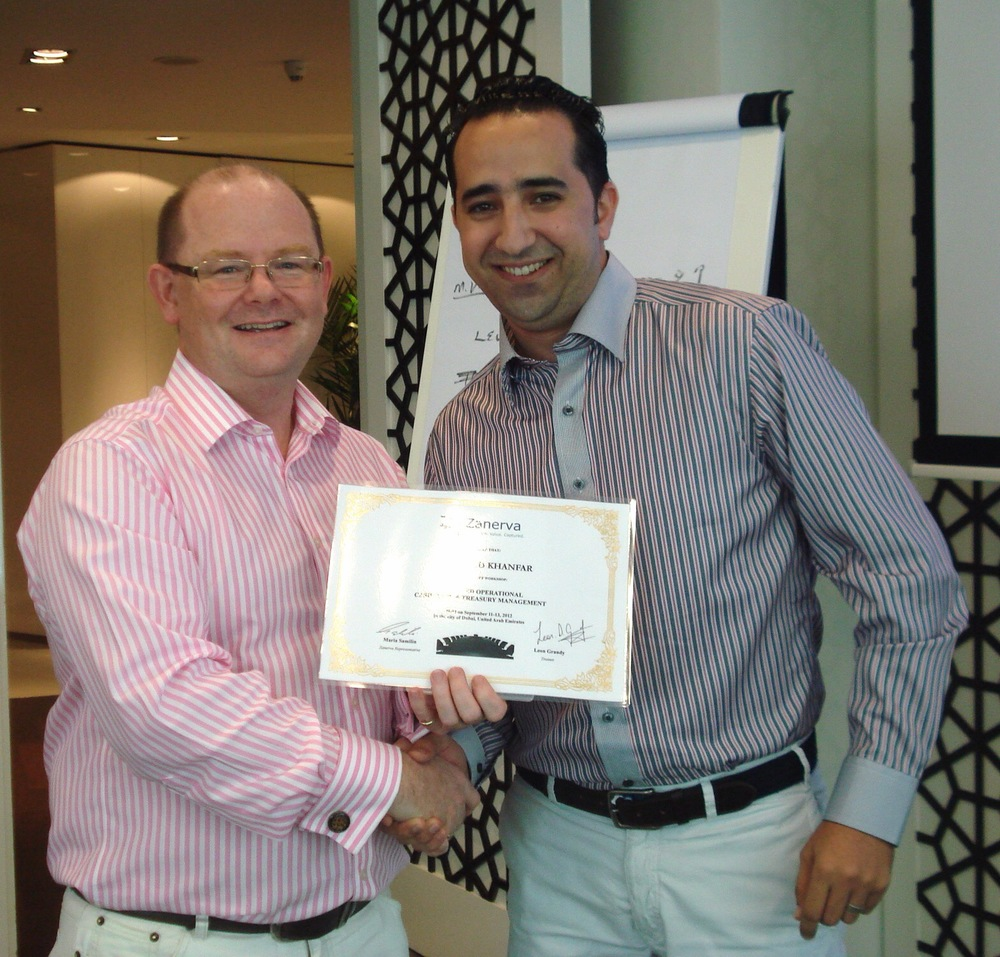 Tariq Ziad Khanfar, Accounting Supervisor at Jordan Bromine Company Ltd  receiving his certificate of participation for attending the Advanced Operational Cash Flow & Liquidity Risk Management workshop in Dubai