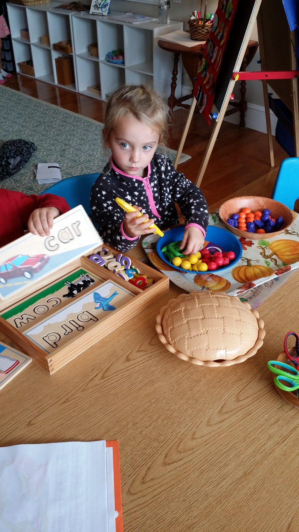 - Sorting fruit by color.  When using the tweezers, the child is strengthening the hand and preparing for grip.