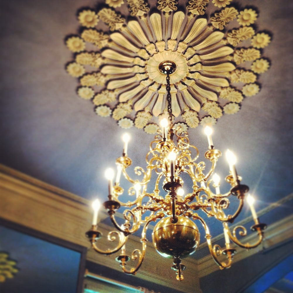 An exquisite chandelier and ceiling medallion.