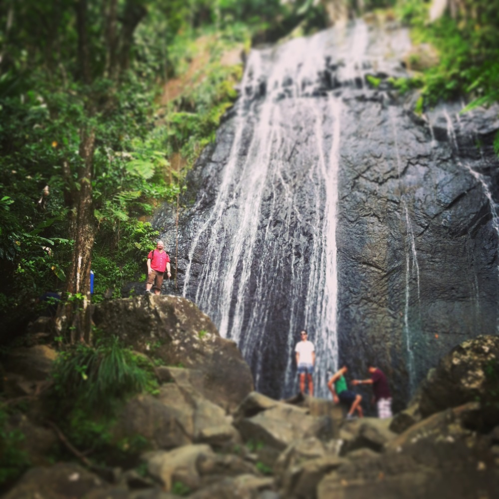 This is my tiny husband in red, Fred, standing in front of La Coca Falls!