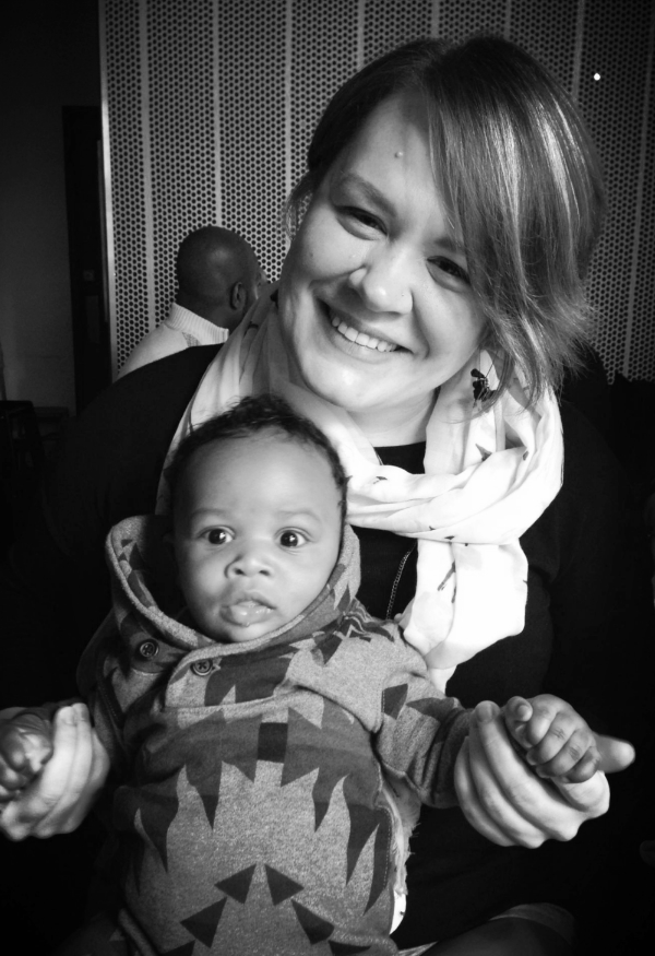 Sarah Lovell and a baby she befriended after she helped his mom.