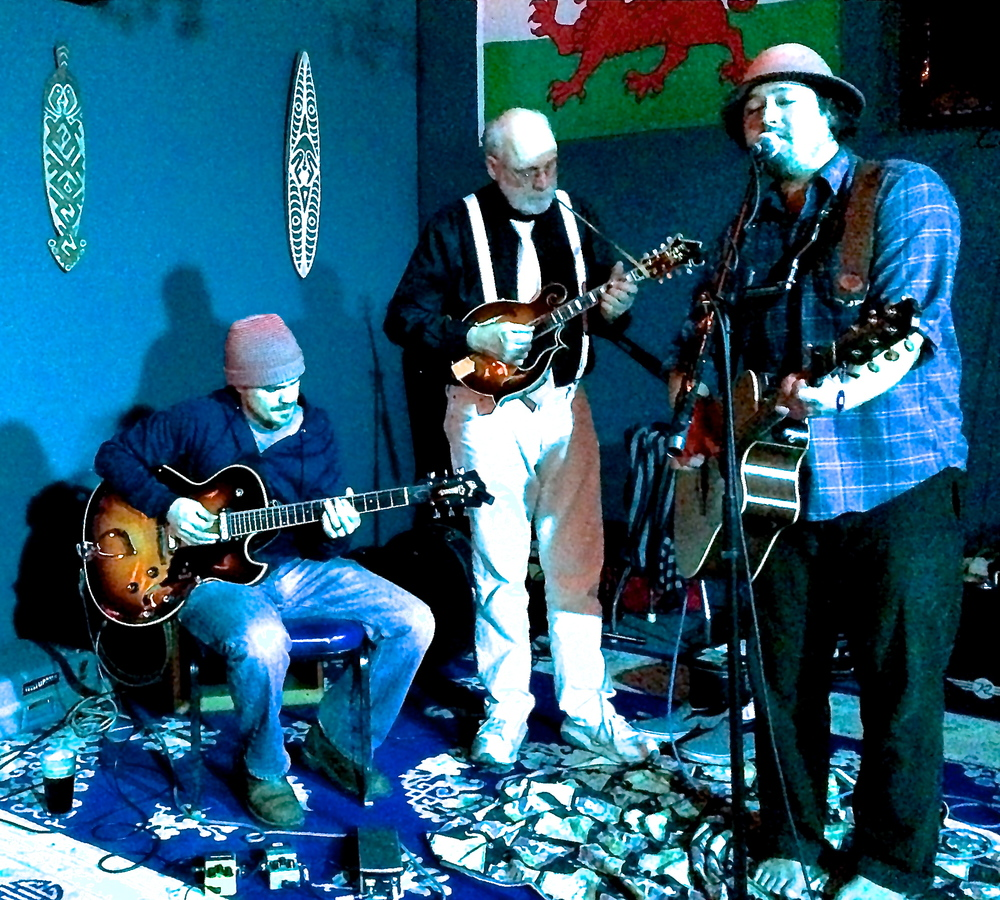 Here is a photo of Slim Bacon on the Right playing with Doc James center at The Blue Room Bar January 23