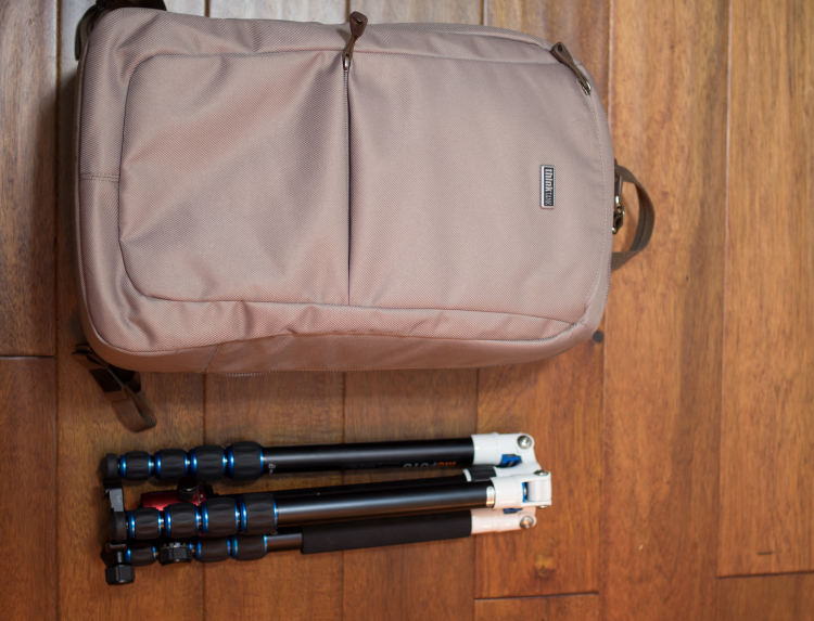 The tripod shown is a MeFoto Roadtrip. This is a small tripod and is shown to help give a sense of the small nature of this pack.