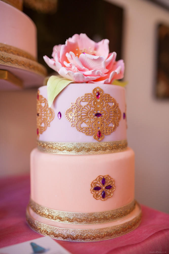 Pink wedding cake with floral decoration by bella cake pantry 1