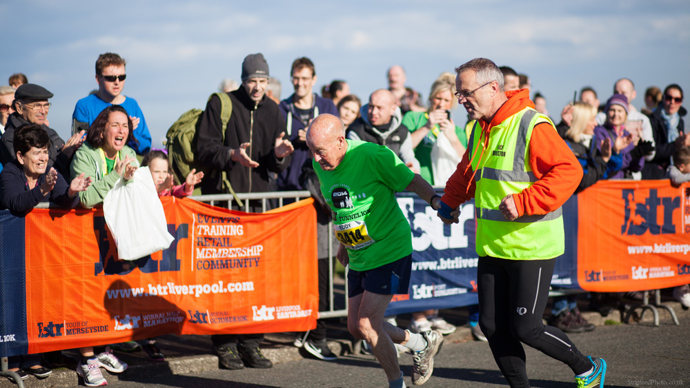 A ninety one year old runner completes the 2014 BTR Wirral Half Marathon in New Brighton